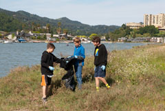 Students from Marin Country Day School gather litter along Corte Madera Creek